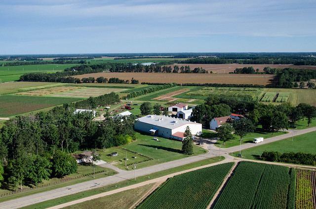 Aerial view of agricultural buildings and fields